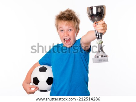 jubilation boy with ball and cup - stock photo