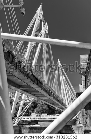 Jubilee Bridge in London over river Thames. - stock photo