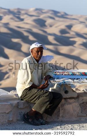 JUDE DESERT, ISRAEL - SEPTEMBER 26: Bedouin man traditionally dressed selling souvenirs. September 26 2014. - stock photo