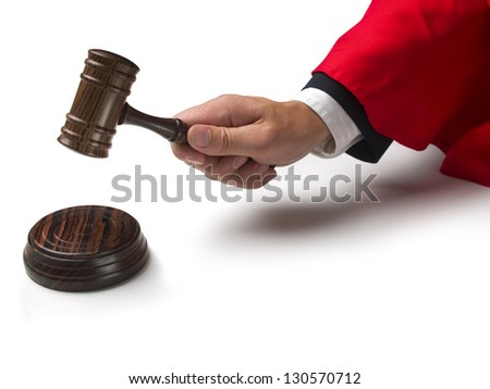judge banging down on a gavel - stock photo