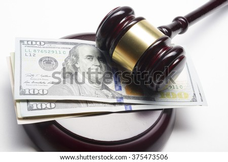 judge gavel and american dollars on white background - stock photo