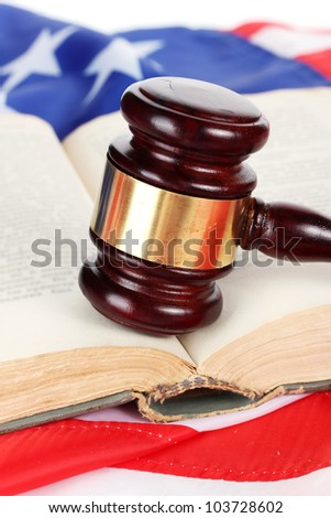 judge gavel and book on american flag background - stock photo