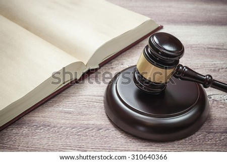 judge gavel and book on the brown wooden table, justice - stock photo