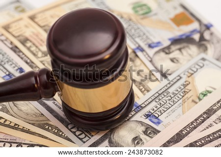 Judge gavel and dollar banknotes - stock photo