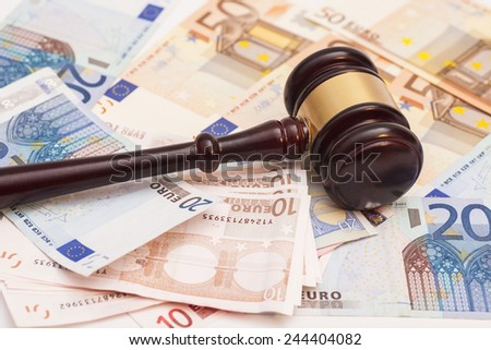 Judge gavel and euro banknotes - stock photo