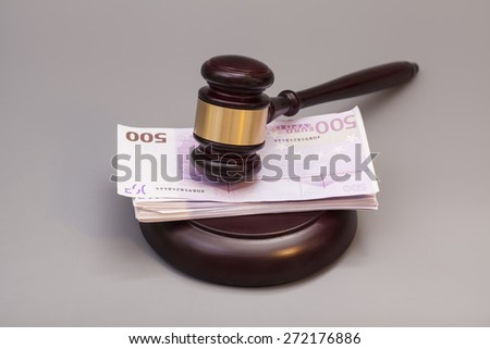 Judge gavel and euro banknotes isolated on gray - stock photo