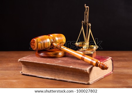 judge gavel and scales on the book