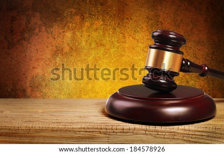Judge gavel and soundboard on wooden table