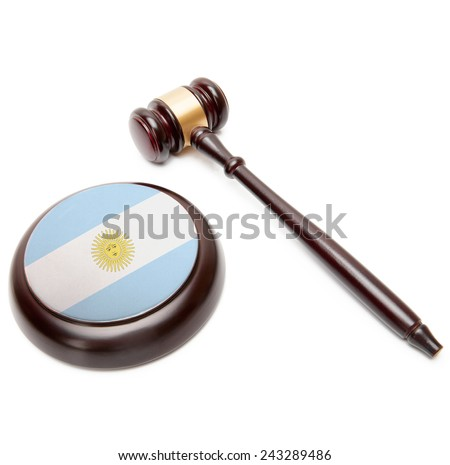 Judge gavel and soundboard with national flag on it - Argentina - stock photo