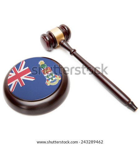 Judge gavel and soundboard with national flag on it - Cayman Islands - stock photo
