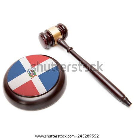 Judge gavel and soundboard with national flag on it - Dominican Republic - stock photo