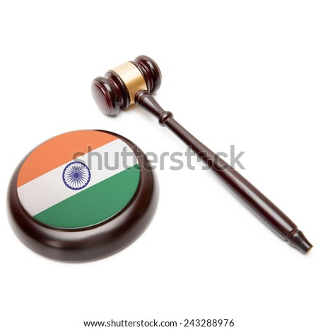Judge gavel and soundboard with national flag on it - India - stock photo