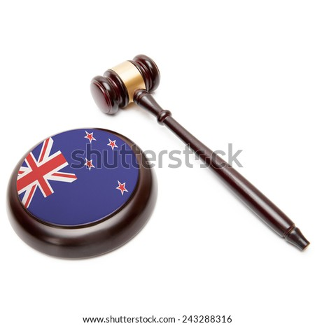 Judge gavel and soundboard with national flag on it - New Zealand - stock photo