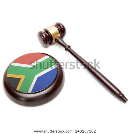 Judge gavel and soundboard with national flag on it - Republic of South Africa - stock photo