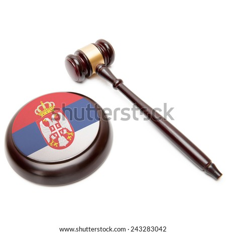 Judge gavel and soundboard with national flag on it - Serbia - stock photo