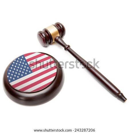 Judge gavel and soundboard with national flag on it - United States - stock photo