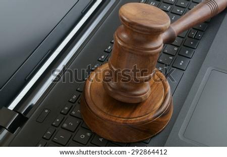 Judge gavel on laptop computer - stock photo