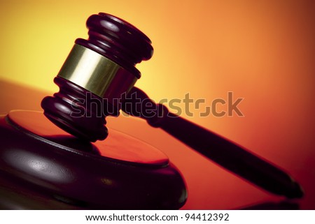 judge gavel on orange background - stock photo