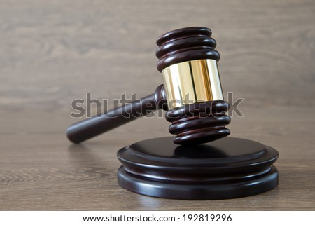 judge gavel on the brown wooden background