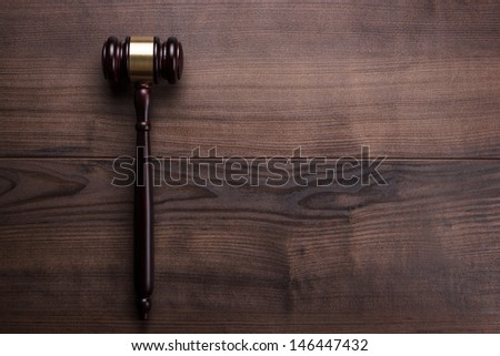 judge gavel on the brown wooden table with space for text - stock photo