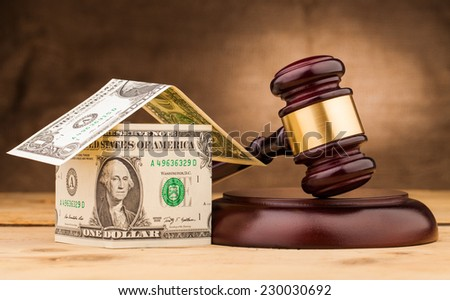 judge gavel with money house closeup - stock photo