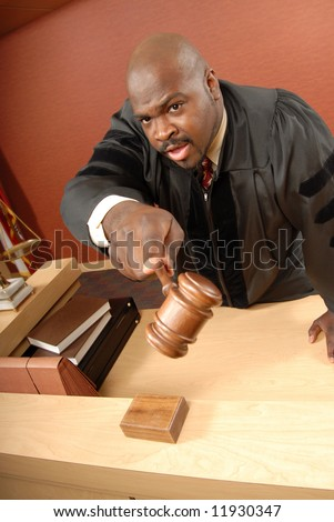 Judge giving instructions to the court - stock photo