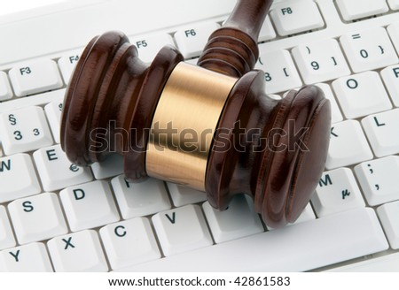Judge hammer and keyboard. Legal certainty on the Internet. Webauktionen. - stock photo