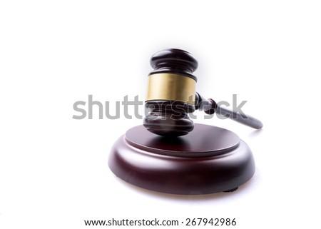 judge hammer on isolated background - stock photo