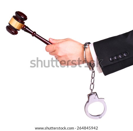 Judge hand with gavel in handcuffs isolated on white - stock photo