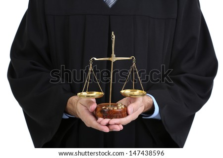 Judge holding scales isolated on white - stock photo