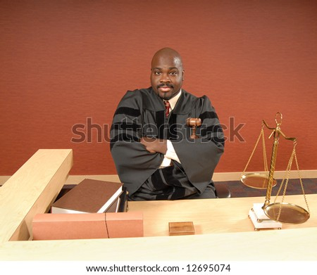 Judge in his courtroom listening to the trial - stock photo