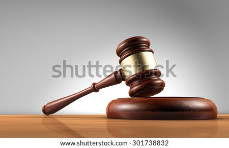 Judge, law, lawyer and Justice concept with a 3d render of a gavel on a wooden desktop with grey background. - stock photo