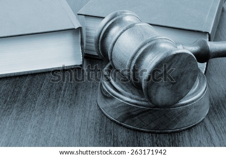 Judge's gavel and legal books  - stock photo
