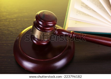 Judge's gavel and open book on table - stock photo