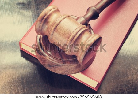 stock-photo-judge-s-gavel-and-red-legal-