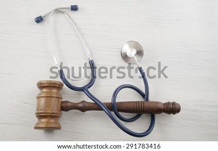 Judge's gavel and stethoscope - stock photo