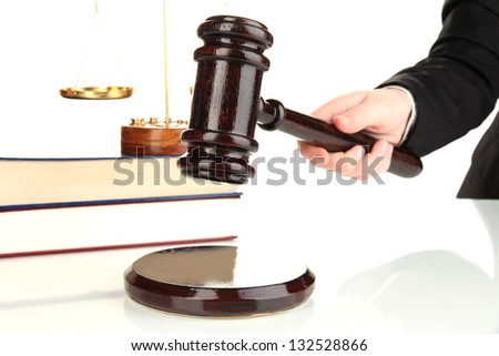 Judge's gavel in hand isolated on white - stock photo