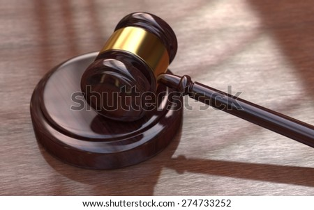 Judge, wooden gavel on the brown wooden background - stock photo