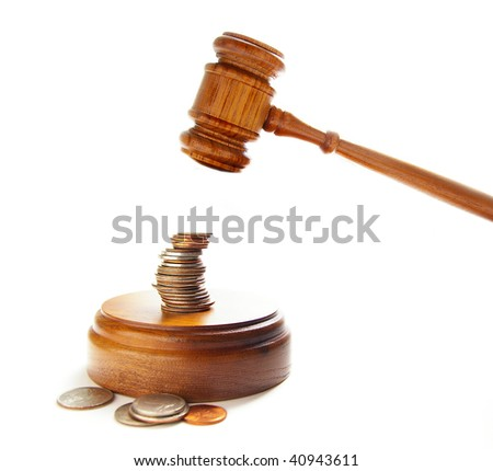 judges court gavel about to pound on money - stock photo