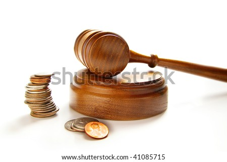 judges court gavel and assorted coins, on white - stock photo