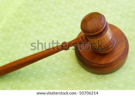 judges court gavel on dollar sign pattern - stock photo
