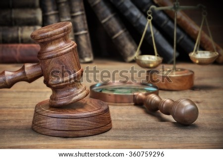 Judges Gavel, Old Book, Vintage Magnifier And Retro Scale On The Rough Wooden Table Background - stock photo