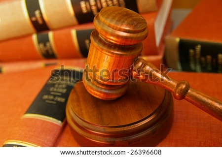 Judges gavel on a pile of law books - stock photo