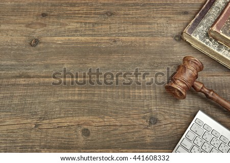Judges Or Auctioneer Gavel, Computer Keyboard And Old Law Books On Grunge Wood Background, Overhead View, Copy Space, Justice Or Auction Concept - stock photo