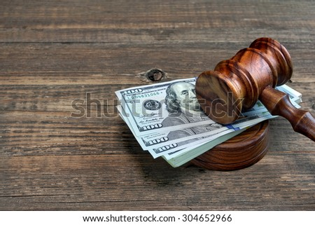 Judges or Auctioneer Gavel, Soundboard And Bundle Of Dollar Cash On The Rough Wooden Table. Idea For Corruption, Bankruptcy Court, Bail, Business And Financial Crime, Bribing, Fraud, Auction Bidding - stock photo