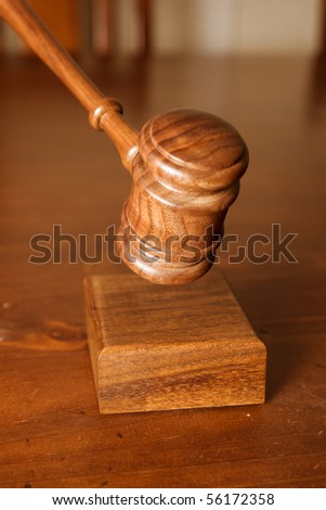 judges or auctioneers gavel  coming down and hitting the block - stock photo