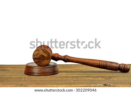 Judges Or Auctioneers Wood Rough Desk With Gavel On The Sound Board Isolated On White Background With Copy Space. Judicial System Concept - stock photo