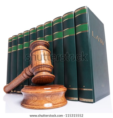Judges wooden gavel and law books on white background - stock photo