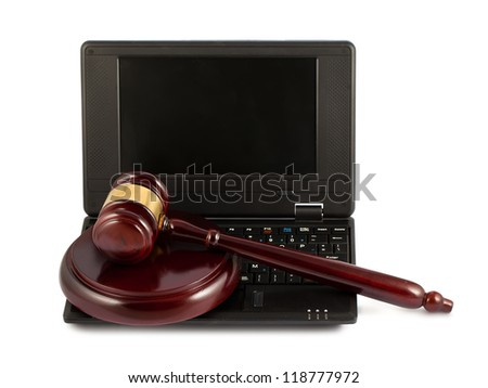 Judges wooden gavel on a black laptop computer keyboard - stock photo