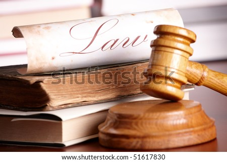 Judges wooden gavel with very old books and paper with word law - stock photo